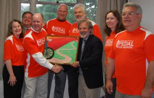 FPC's Pedal For Promise 2013 team (L-R):  Debra Califf, Paul Califf, Brian Archibald (holding picture), Ed Haversang, Rich Heun, Jim Cummings (holding picture), Diane Van Leer, Rey Mercado.  Cyclists who participated but not pictured:  Duane and Ann Jacobsen.